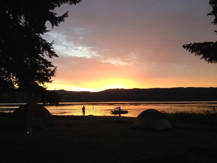 Campsite with lake in background at sunsetCottage Grove Lake at sunset