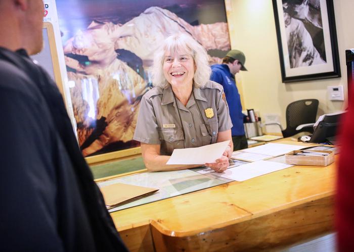 Visitor Desk at the Walter Harper Talkeetna Ranger StationVisitors speak to Ranger Pam while in Talkeetna