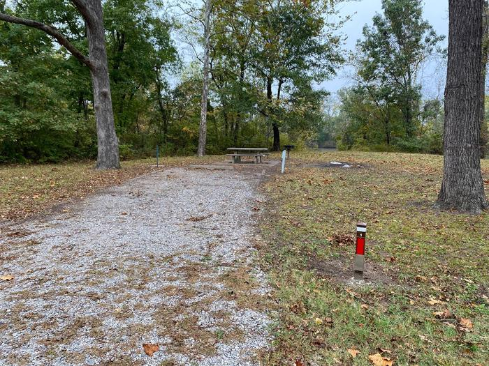 Site 1 - Bluff LandingThis site is heavily shaded with a gravel drive/slab. The site comes equipped with a picnic table, grill and a firepit to enjoy while camping. Enjoy the view of the river with direct access down to the bank right behind the campsite.