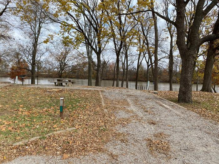 Site 21 - Bluff LandingThis site is partially shaded and has a gravel driveway/slab. It is equipped with a picnic table, grill and fire pit for you to enjoy, located right next to the boat ramp with great access to the river bank.