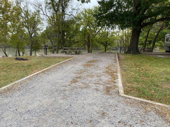 Site 22 - Bluff LandingThis site is partially shaded and has a gravel driveway/slab. It is equipped with a picnic table, grill and fire pit for you to enjoy, located right next to the boat ramp with great access to the river bank.