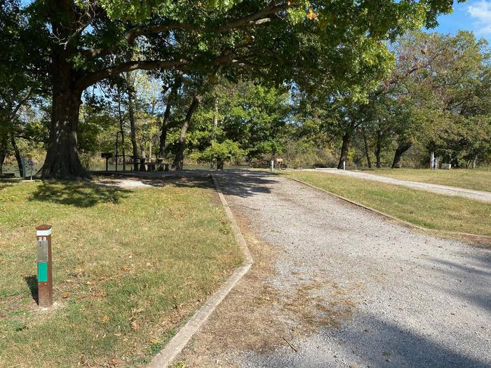 Site 23 - Bluff LandingThis site is partially shaded and has a gravel driveway/slab. It is equipped with a picnic table, grill and fire pit for you to enjoy, located in close proximity to the boat ramp with great access and view of the river bank.