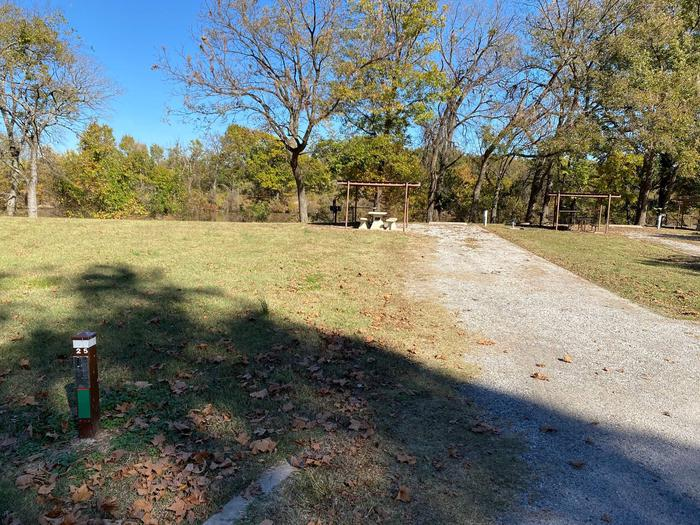 Site 25 - Bluff LandingThis site has a gravel driveway/pad to park your camper on and is equipped with a picnic table, grill and fire ring at your disposal. Located close to the boat ramp with a great view and access to the river bank.
