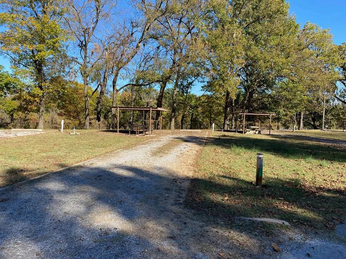 Site 26 - Bluff LandingThis site has a gravel driveway/pad to park your camper on and is equipped with a covered picnic table for extra shade, a grill and fire ring at your disposal. Great view and access to the river bank.