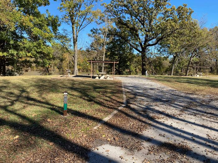 Site 28 - Bluff LandingThis site has a gravel driveway/pad to park your camper on and is equipped with a covered picnic table for extra shade, a grill and fire ring at your disposal. Great view and access to the river bank.