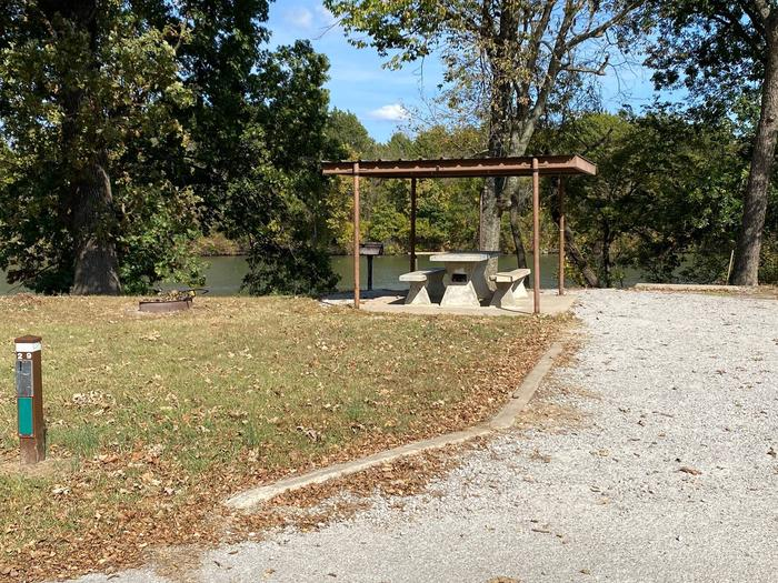 Site 29 - Bluff LandingEnjoy a nice quiet spot at the the very end of the east loop. This site is equipped with a grill and fire ring, along with a covered picnic table for extra shade and cover from the elements. Great view and access to the river bank.
