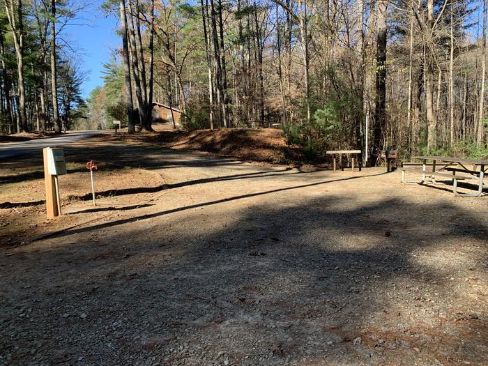 Pull through gravel site with table, fire pit, grill, Pull through site with table, fire pit, grill