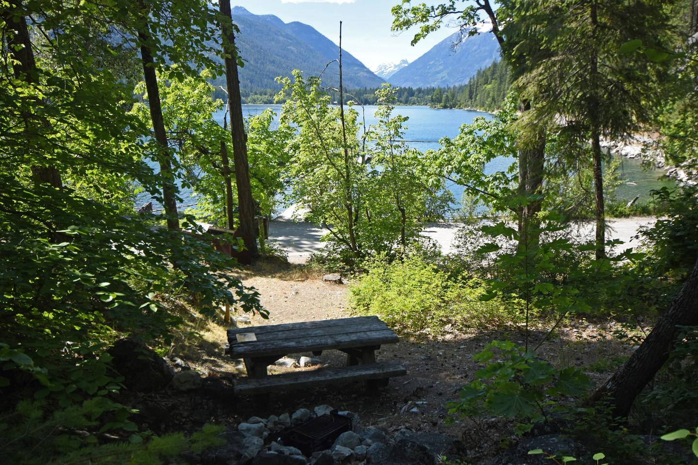 Campsite with picnic table and tent pad overlooking lakePurple Point Site 2