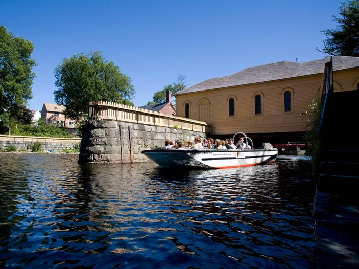 Boat Tour on Pawtucket CanalPark Ranger speaking to visitors outside of Wannalancit Mill Building, historically the Suffolk Mill in Lowell.