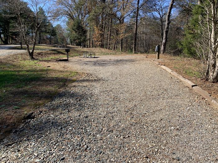 Long gravel pull in site fire pit, table, grill