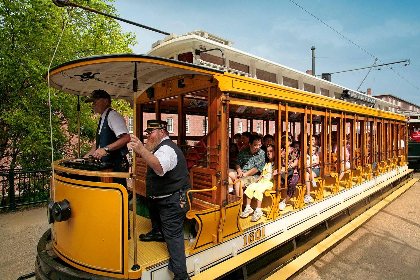 View of trolley with passengersGroup of visitors on a park trolley