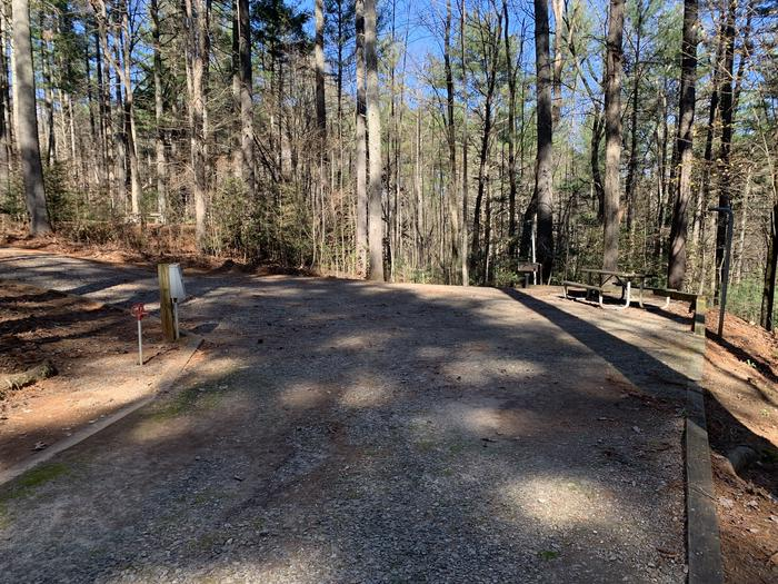 Gravel pull through site with fire pit, table, grill