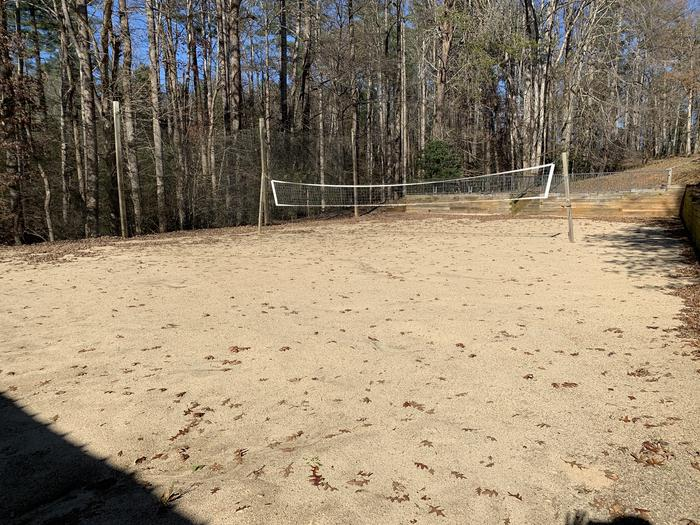 Sand volleyball court with net behind Tom Shelter Sand volleyball court behind shelter