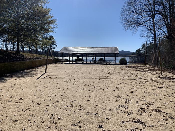 Volleyball court looking towards shelter and lake