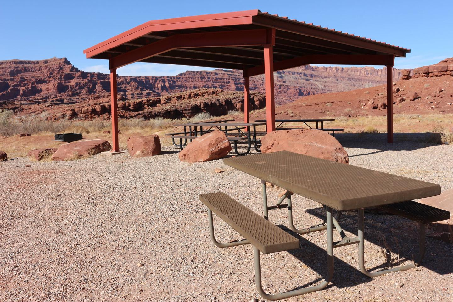 Close up of shade shelter and picnic tables.