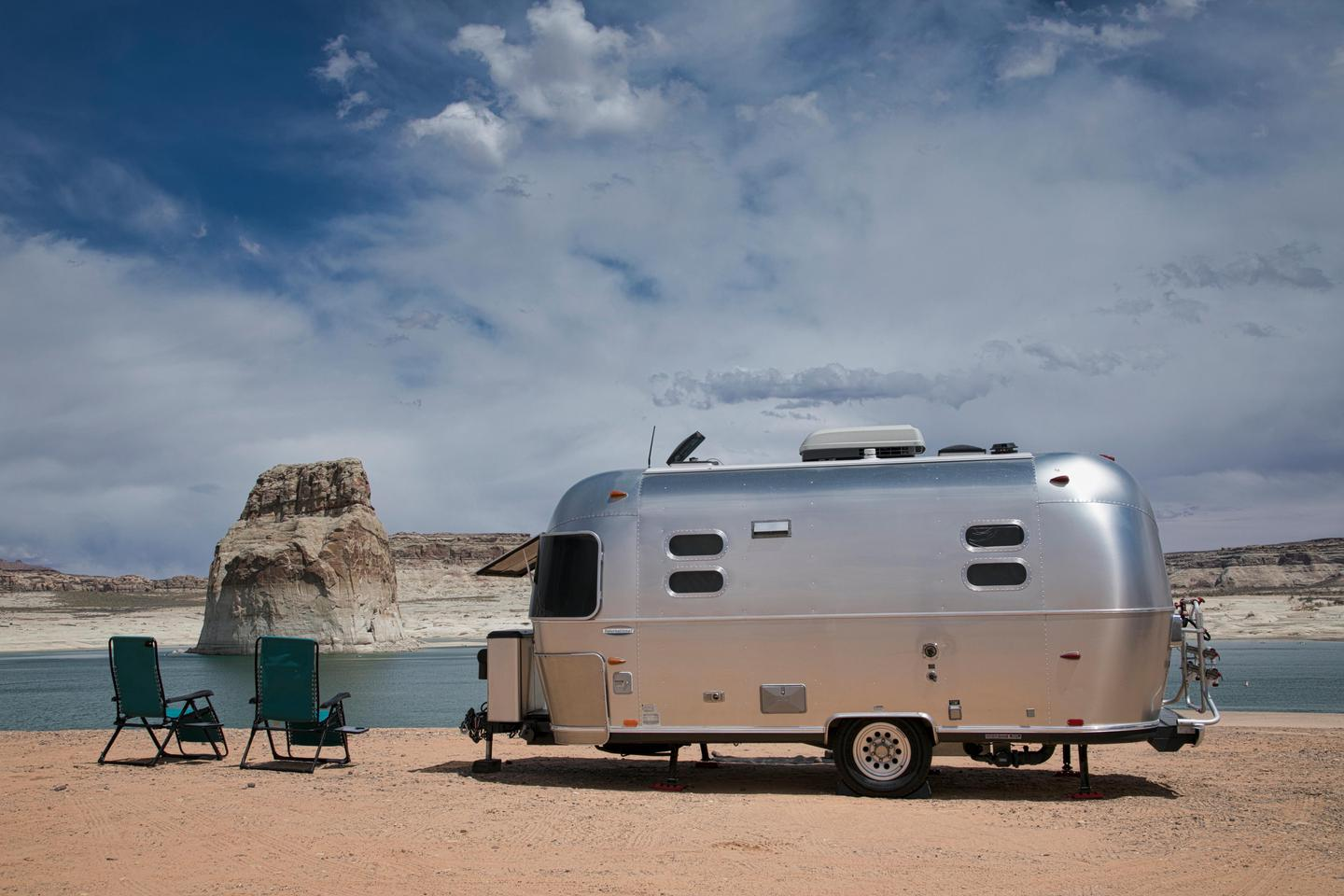 Lone Rock Beach Primitive Camping - TrailerPark yourself for a few nights on the beach at Lone Rock