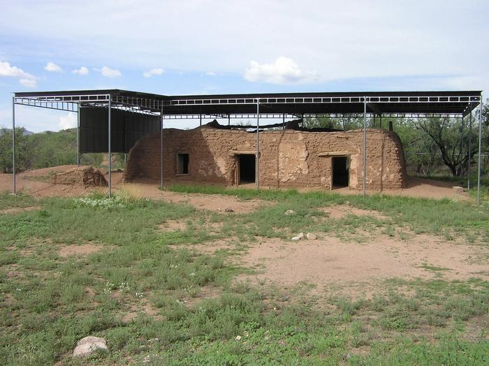 The Ruins of Mission San Cayetano de Calabazas, with a metal roof above that protects the adobe walls.Tucked away in modern-day Rio Rico, the Calabazas site underwent a long sequence of adaptations from mission, to stock ranch, to post office, customs house, Army base, and more.