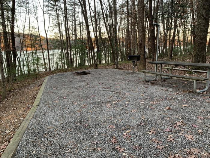 Grave site with table fire pit, and grill