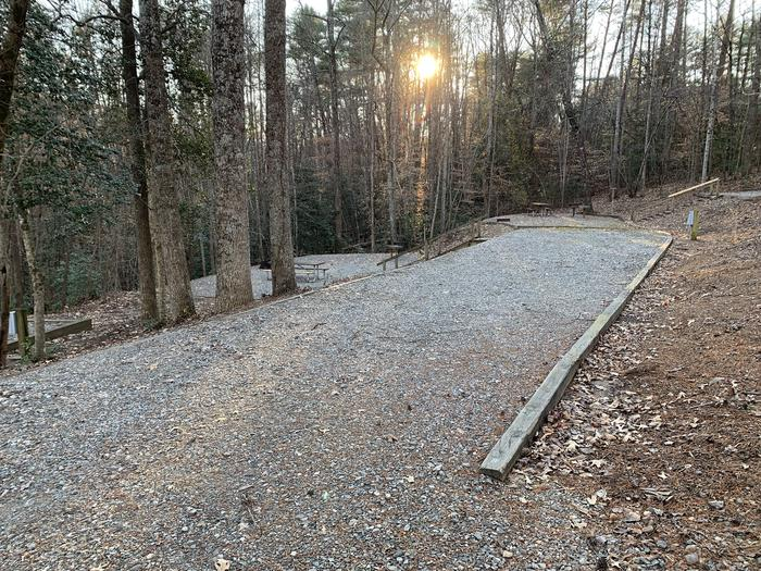 Long gravel pull in with steps down to site