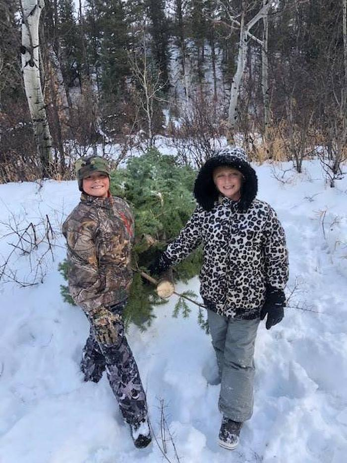 Time to bring home the Christmas TreeThese siblings work together in the GMUG NF for their Christmas Tree