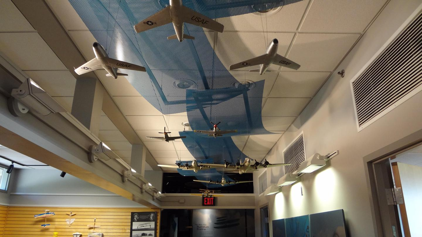 Skies AboveModel airplanes strung above visitor's heads in the hallway of the visitor center.
