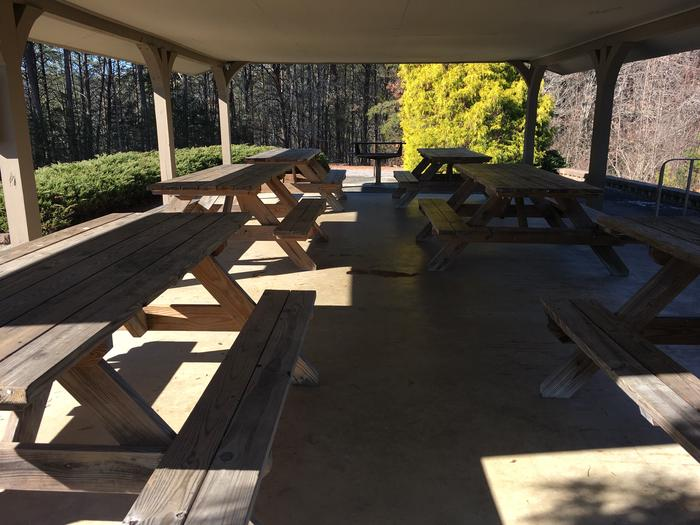 Picnic tables and grill under shelter Picnic tables and grill