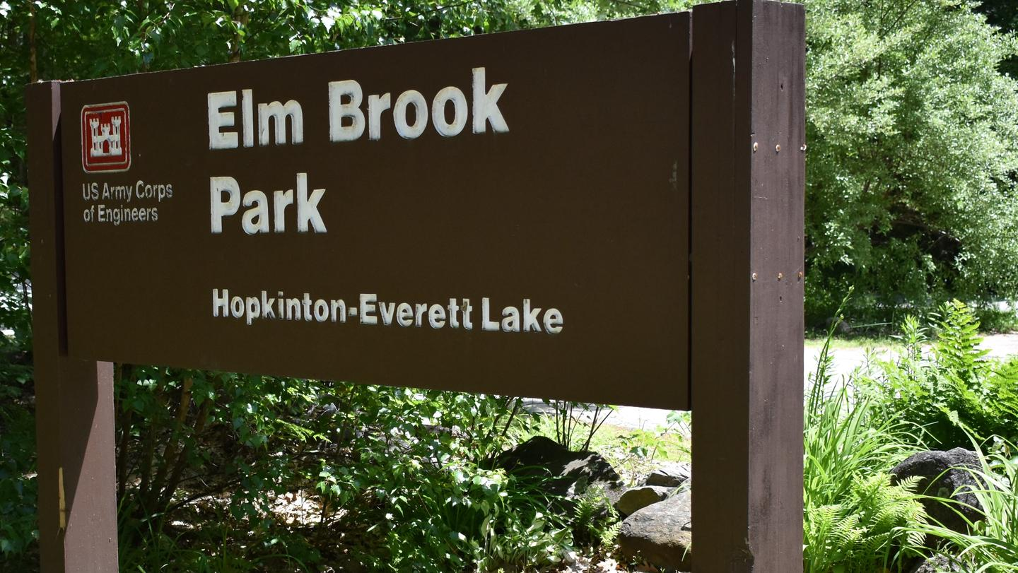 A close-up of the Elm Brook Park sign near the main entrance of the park.Elm Brook Park Sign