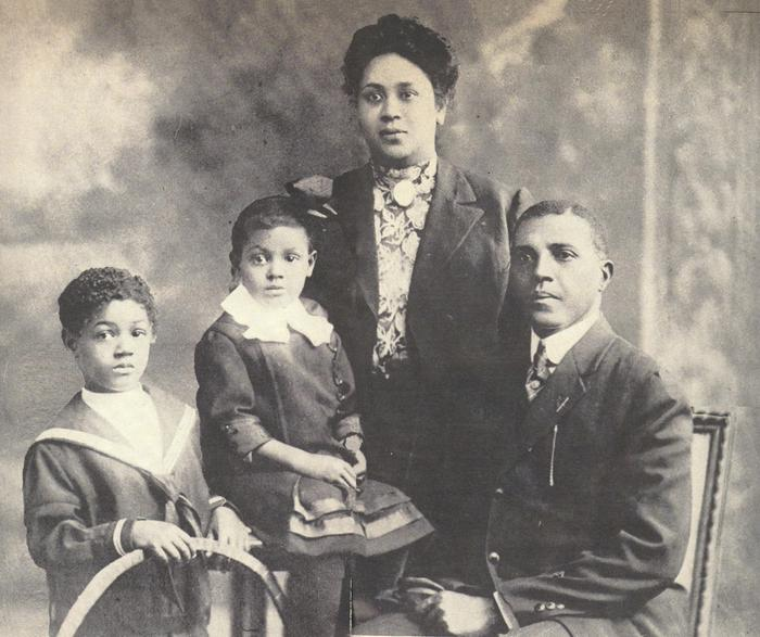 Charles Young and familyCharles Young (far right) poses with his family, Ada Young (standing rear), Charles Noel (far left), and Marie Aurelia (sitting middle).