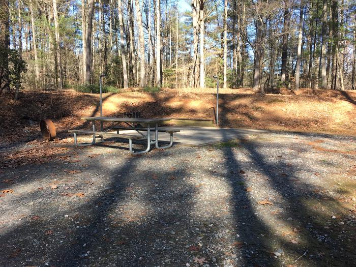 Gravel site with fire pit, table, grillGravel site with fire pit, table, grill
