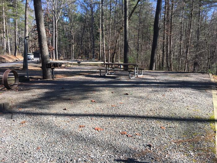 Gravel site with table, fire pit, grill Gravel site with fire pit, table, grill