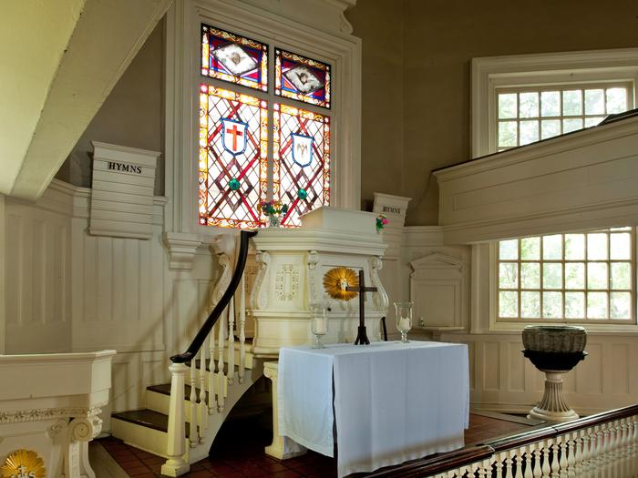 Interior of the Gloria Dei ChurchSituated above the pulpit is the only stained glass window in the church building.  Created in the mid 1800s, the window is the earliest example of American stained glass among the 3600 windows in the Philadelphia region.