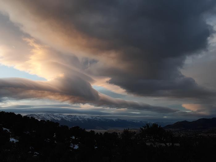 Dramatic clouds and distant snow-capped mountainsGreat Basin Cloud Show