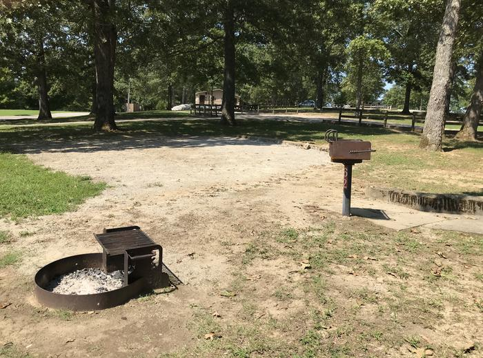 WILLOW GROVE CAMPGROUND SITE #62 CAMPFIRE RING AND PEDESTAL GRILL NEAR GRAVEL TENT PADWILLOW GROVE CAMPGROUND SITE #62