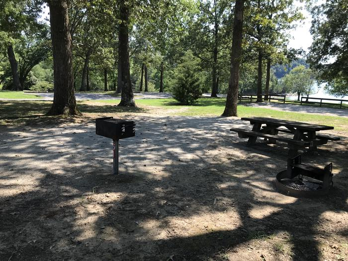 WILLOW GROVE CAMPGROUND SITE #61 GRAVEL TENT PAD WITH GRILLS AND TABLESWILLOW GROVE CAMPGROUND SITE #61