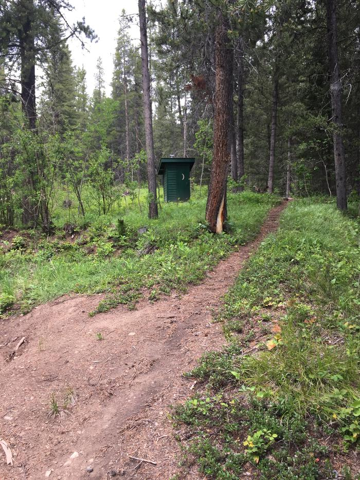 Outhouse in wooded area with footpath leading up to it.Kenck Cabin outhouse