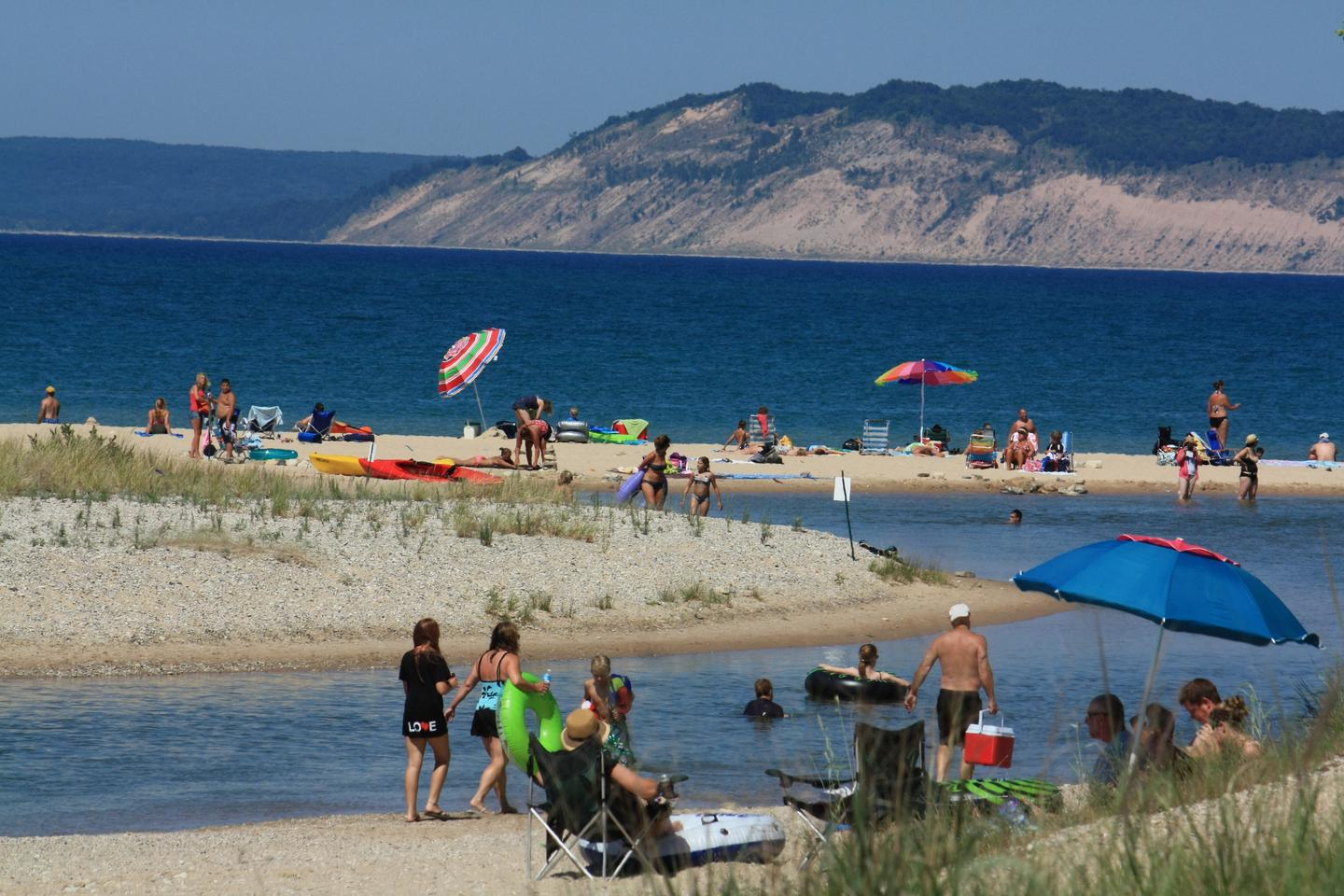 A perfect beach day at Platte River PointBright-colored umbrellas, bathing suits and floats make a festive day at the beach