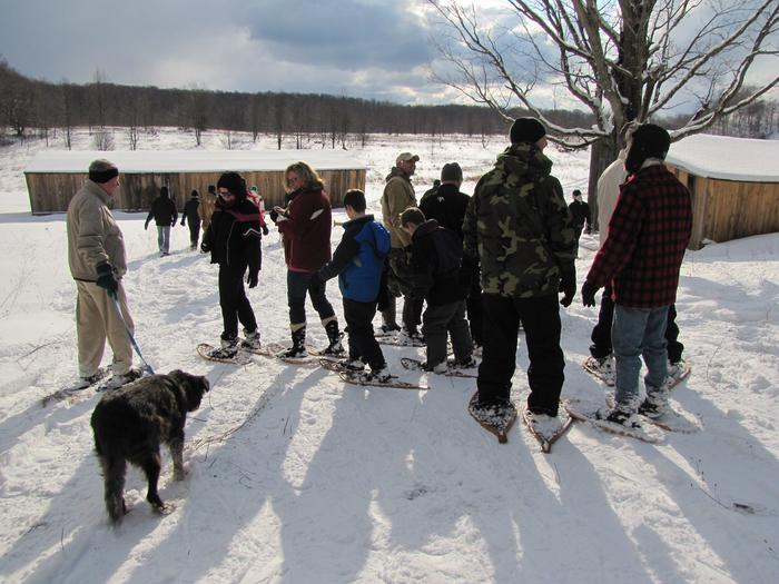 Snowshoe hike at Treat FarmSnowshoers enjoy the sunshine as they explore the Treat Farm in winter