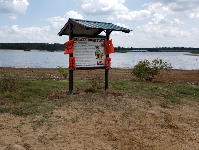 Swim beach at Kiamichi ParkLilly Road offers a swim beach with loaner lifejacket station, nearby playground, picnic tables, and restrooms.