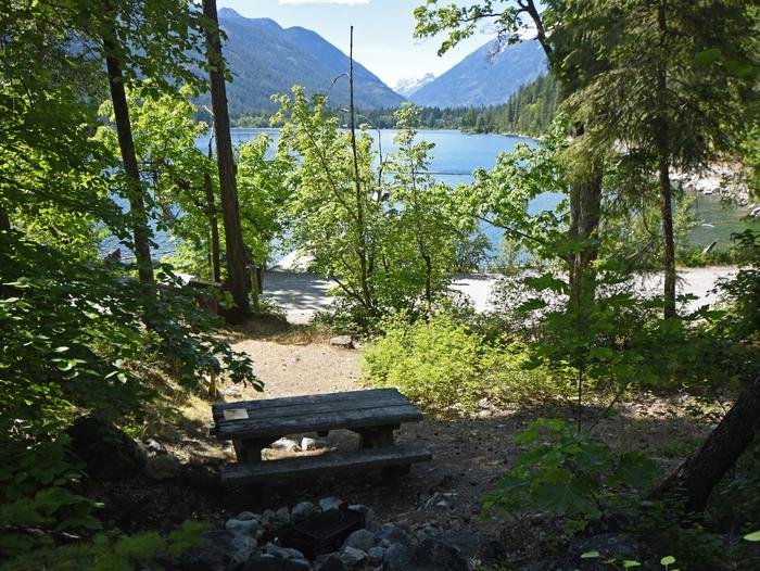 Wooded campsite overlooking lake and mountainPurple Point Site 2