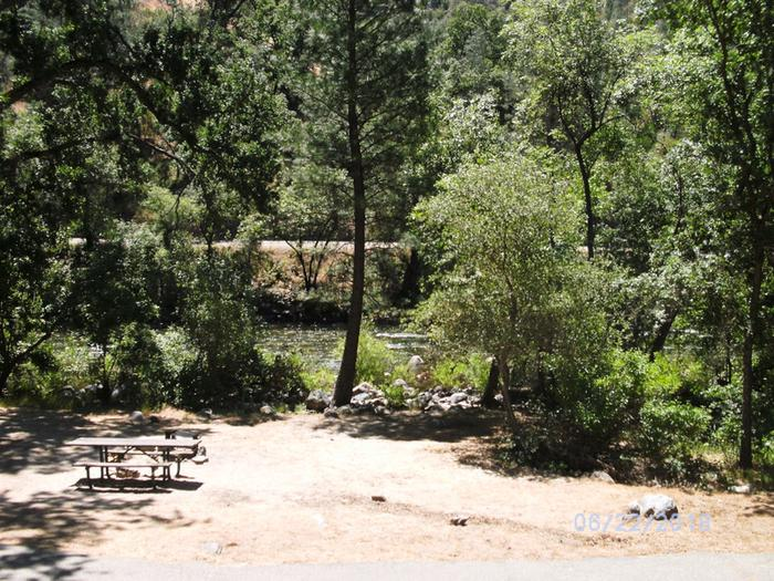 Campsite viewCampsite view with wooded trees, picnic area and grill