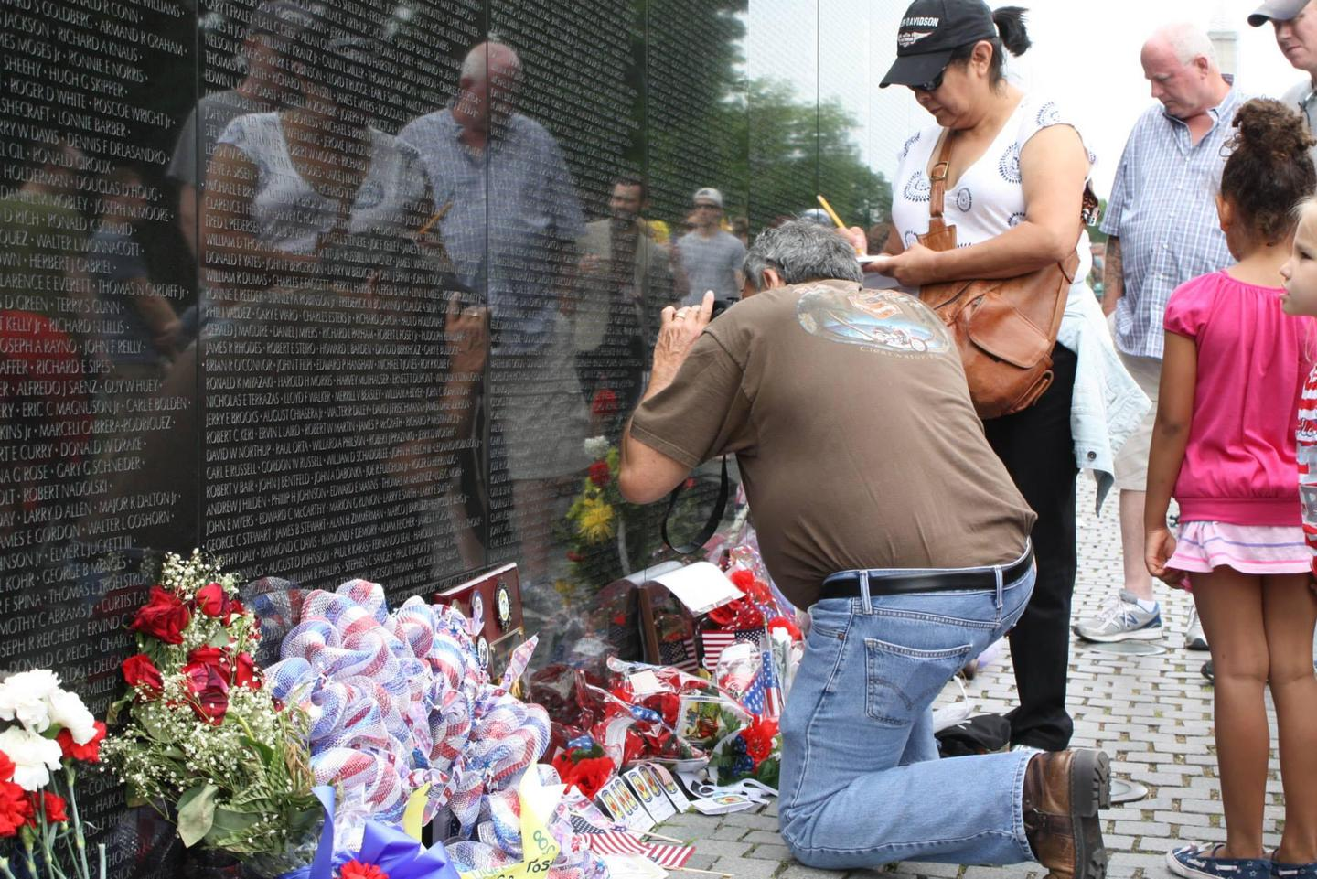 Visitors to the wallMemorial Day weekend is a special time to visit the Vietnam Veterans Memorial.