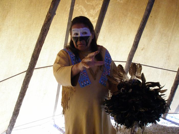 Cheyenne Dog Soldier Telling StoriesA Cheyenne Dog Soldier tells stories inside his tipi