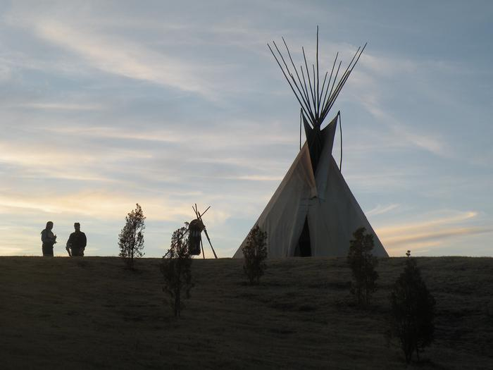 """Meeting the Enemy""A Cheyenne Warrior and U.S. Cavalry soldier hold a meeting next to a tipi"