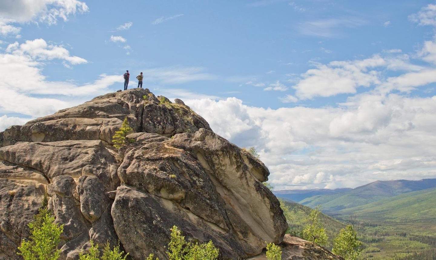 Hikers on Angel RocksHikers on top of Angel Rocks near Fairbanks look out across the landscape of Chena River State Recreation Area