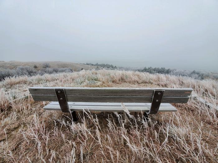 Frosty bench and grass at the Beaver Creek Recreation Area overlook.Frosty fall day at the Beaver Creek overlook.