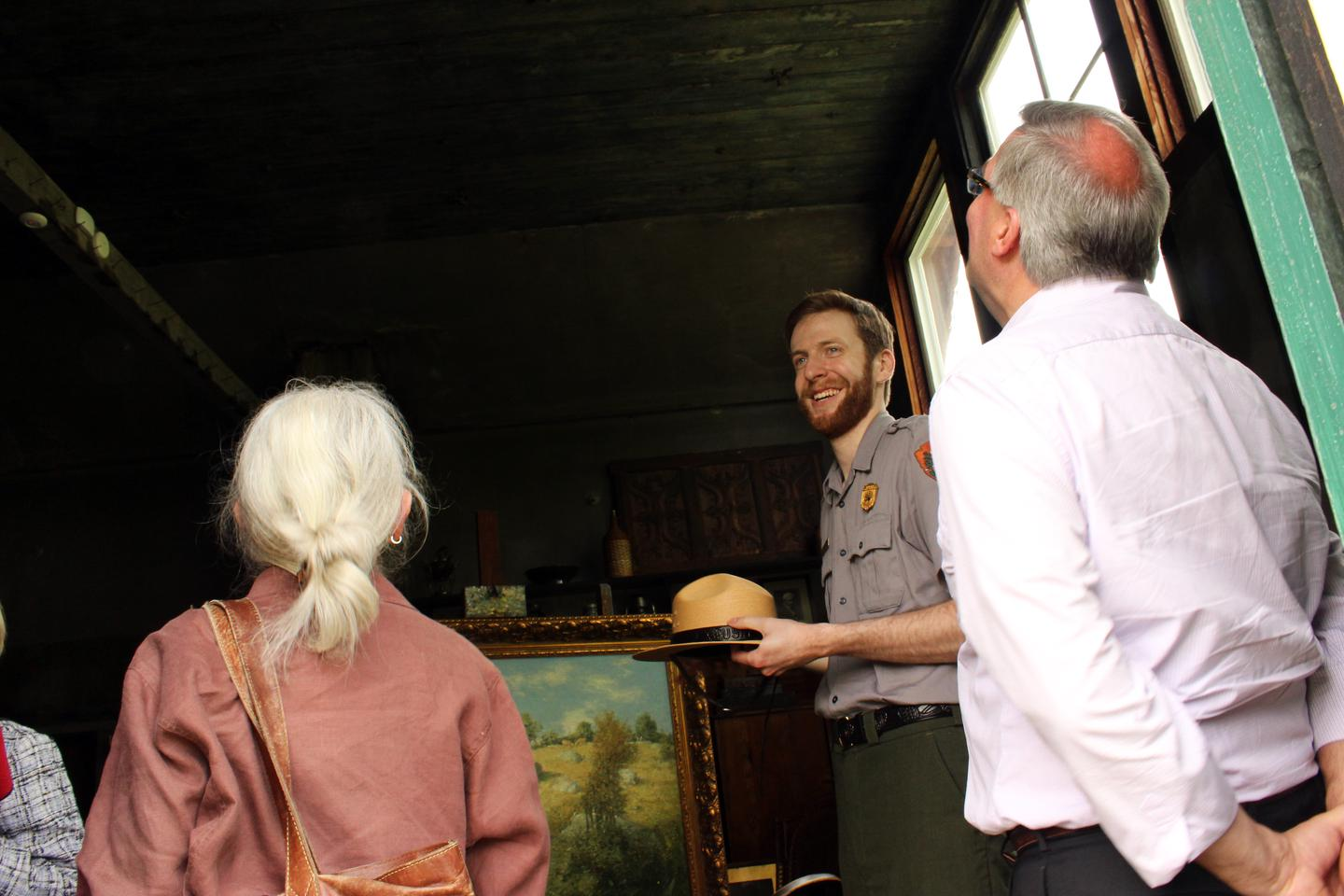 Park Ranger in the Weir StudioPark Ranger Andrew Lowe, talks to two visitors about the Weir Studio in May 2014.
