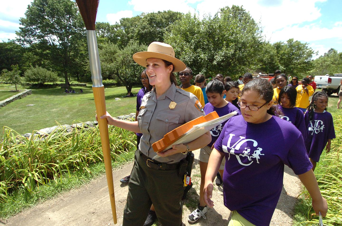 Ranger with Girl ScoutsPark Rangers lead tours of students and Girl Scouts throughout the year.