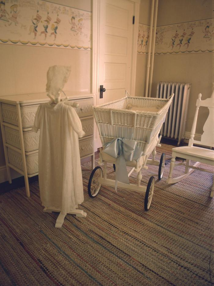 NurseryThe Kennedy christening gown on a stand next to the bassinet in which all the Kennedy children slept, at the John F. Kennedy National Historic Site.
