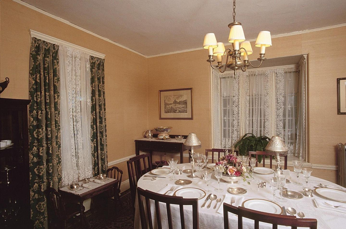 Kennedy Dining RoomThe dining table is set with the fine china and silver that Rose Kennedy received as a wedding present.
