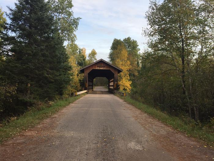 Smith Rapids Covered Bridge With Early Autumn ColorsSmith Rapids Covered Bridge provides a scenic stop to enjoy the South Fork of the Flambeau River.